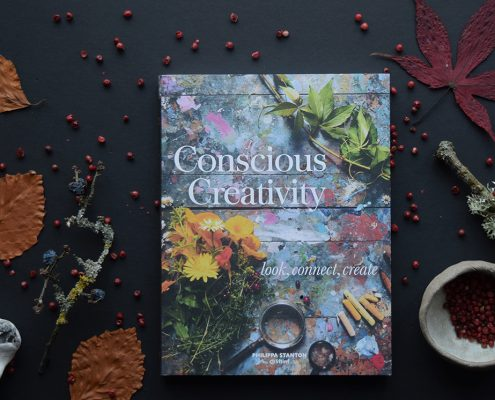 Flatlay of book Conscious Creativity for Curly Carrot