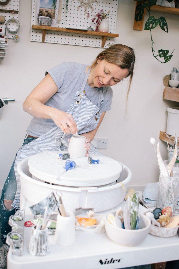 Potter Katie Robbins working at her wheel.